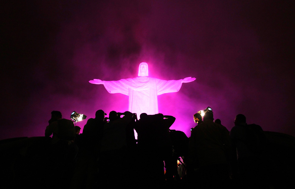 "The statue of Christ the Redeemer is lit up in pink for the start of the national campaign ""Pink October"" to raise awareness for breast cancer in Rio de Janeiro, Brazil on October 5, 2010. (REUTERS/Sergio Moraes) www.boston.com"